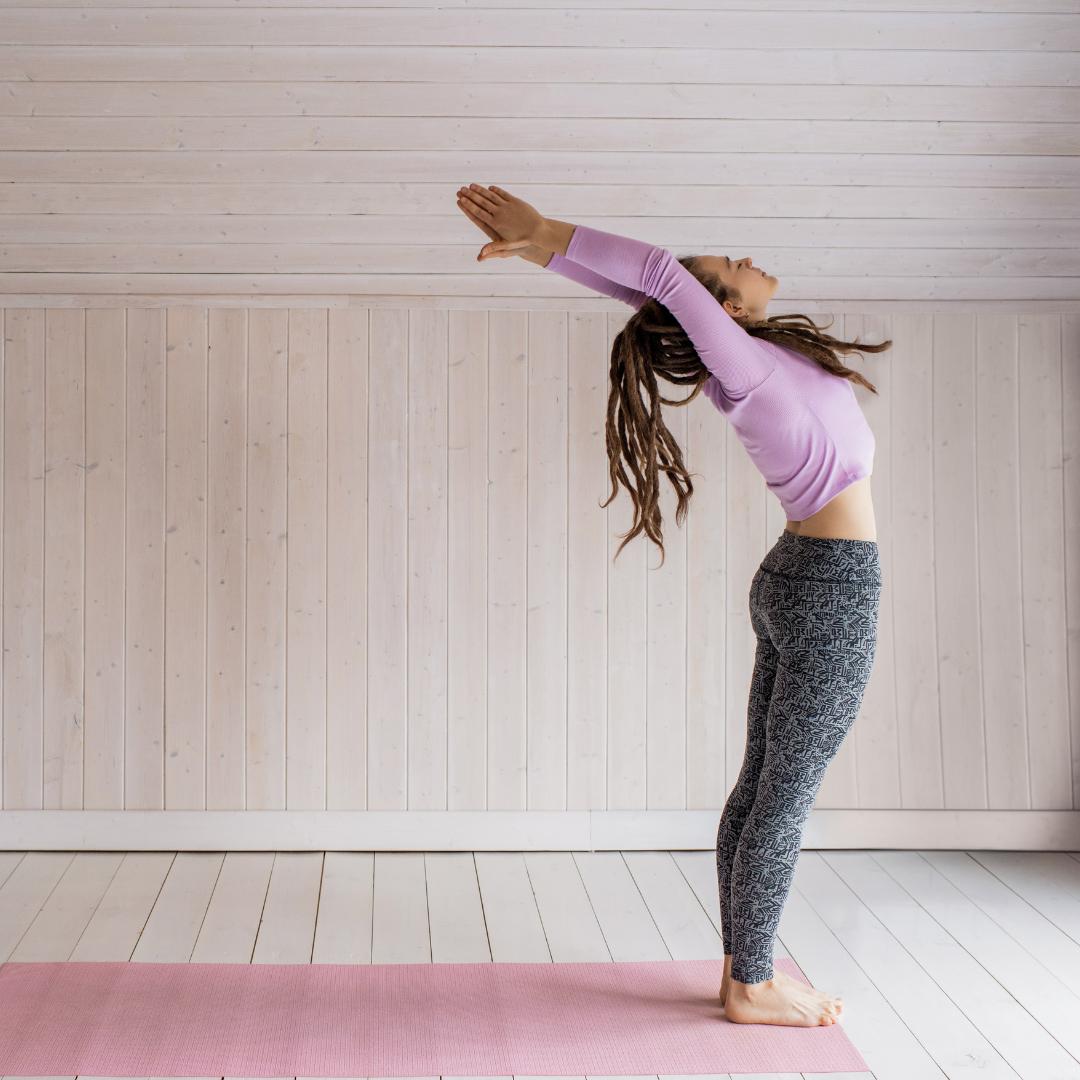 Woman doing indoor yoga